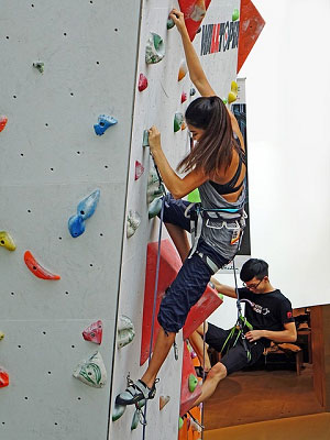 Indoor rock climing on a rainy day can be fun and exercise