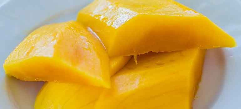Foods to Feed Your Dog That Are Healthier Than Treats mangoes